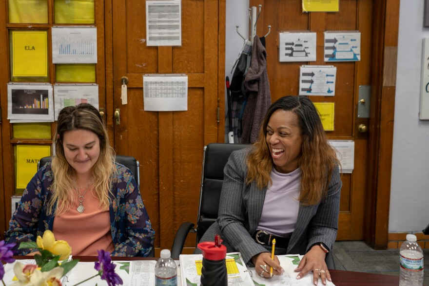 Bryan Hill Principal Sarah Briscoe, right, meets with her attendance team, which includes Andrea Klipsch, one of two student and family mentors from Grace Hill Settlement Home.