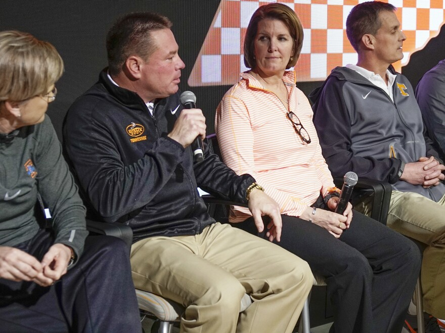 """University of Tennessee coaches, including had football coach Butch Jones (second from left) hold a news conference in February. A federal lawsuit accused Tennessee of violating federal regulations and creating """"a hostile sexual environment."""""""