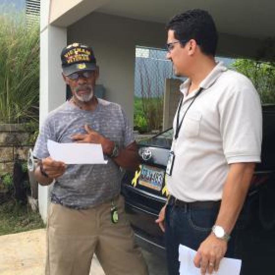 Vietnam veteran Luciano Sevilla-Rivera (left) discusses his medical condition with VA social worker Eduardo Vicenty-Santini. Sevilla-Rivera says his PTSD was triggered by Hurricane Maria.