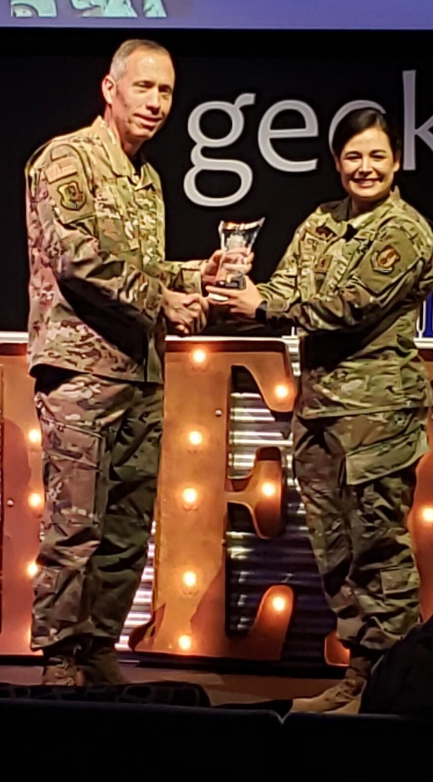 Winner Major Jacque Vasta congratulated by Major General Tom Wilcox.