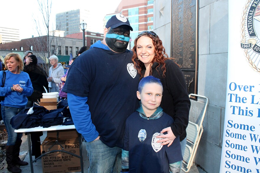 Bill Peiper, Teresa Tate and Colton Tate show their support for law enforcement.