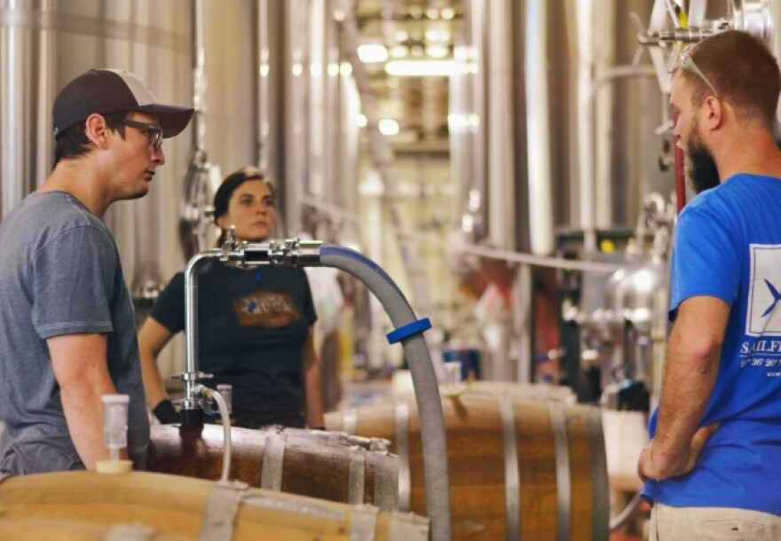 Employees at Hi-Wire Brewing are able to continue to brew beer amidst this pandemic. The Asheville-based taproom has locations in Durham and Knoxville, Tennessee.