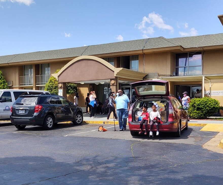 Long-term residents at the Days Inn on East Woodlawn Road waited for the water and electricity to be turned back on at midday Tuesday.