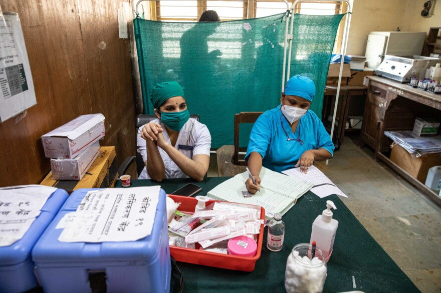Nurses Sarika Patil (left) and Priyanka Gavai (right) in the room in the Palghar Rural Hospital where vaccines are readied.