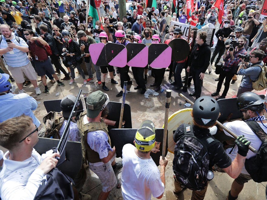 "Following the weekend's violent clashes around a white nationalist demonstration in Charlottesville, Va., some are asking what authorities could have done differently. Above, demonstrators and counter-protestors face off at the entrance to Emancipation Park during Saturday's ""Unite the Right"" rally."