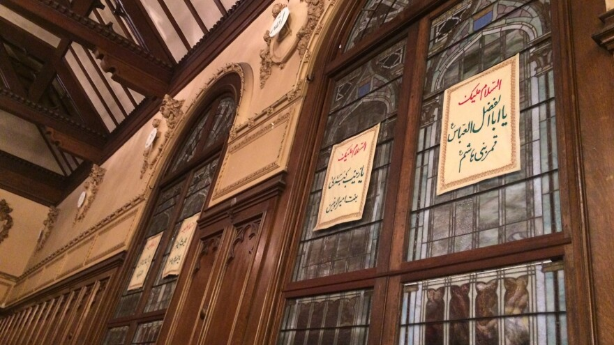 Arabic and Persian calligraphy adorn the tinted windows of the Islamic Cultural Center of Northern California.