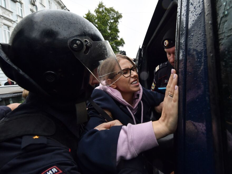 Police officers in downtown Moscow detain Sobol on her way to an Aug. 3 unsanctioned rally demanding fair elections.