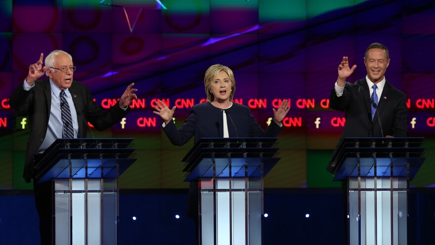 Democrats Bernie Sanders (from left), Hillary Clinton and Martin O'Malley debate in Las Vegas.