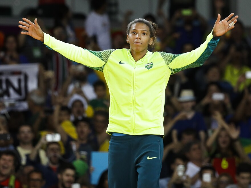Gold medalist Rafaela Silva celebrates during the winners ceremony after the women's 57-kg judo competition in Rio de Janeiro on Monday.