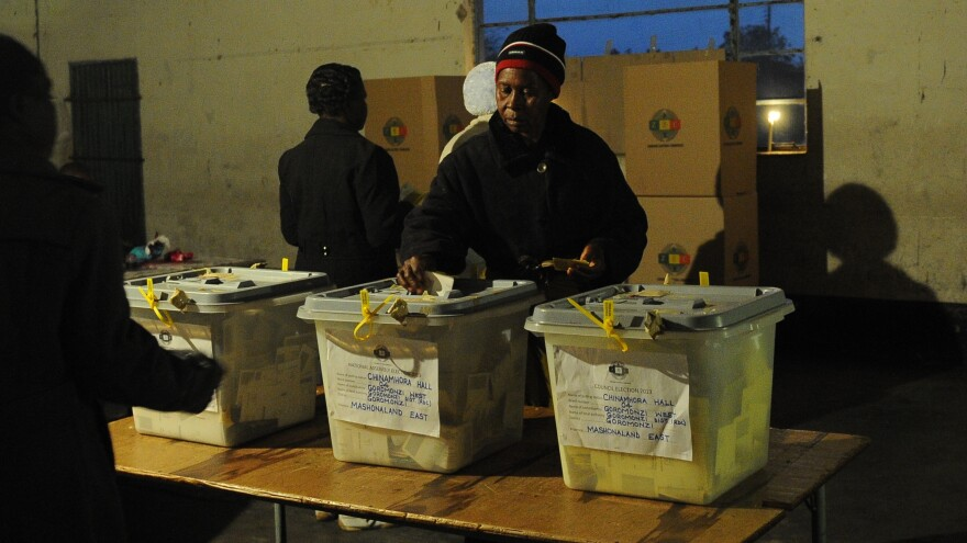 A Zimbabwean woman casts her ballot at a polling station in Domboshava, 37 miles north of Harare, on Wednesday.