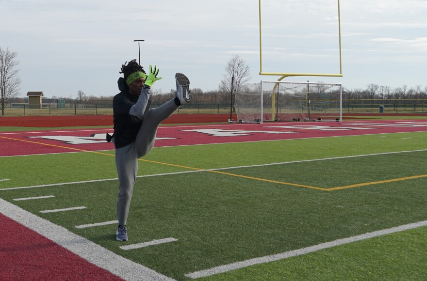 On a cold afternoon, Dawn Harper-Nelson practices hurdling drills at Belleville West High School.