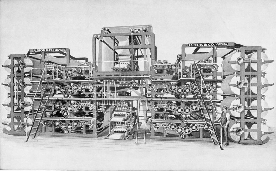 photo of newspaper printing press from the early 20th century