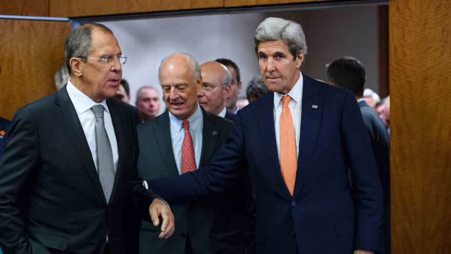 Russian Foreign Minister Sergey Lavrov (left) and U.S. Secretary of State John Kerry (right) enter a news conference room Friday in Geneva to announce a cease-fire agreement for Syria.