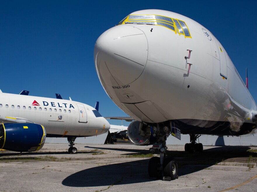 These two jets were among dozens of planes Delta parked at the Birmingham airport in May. Maintenance workers prepped them for long-term storage.