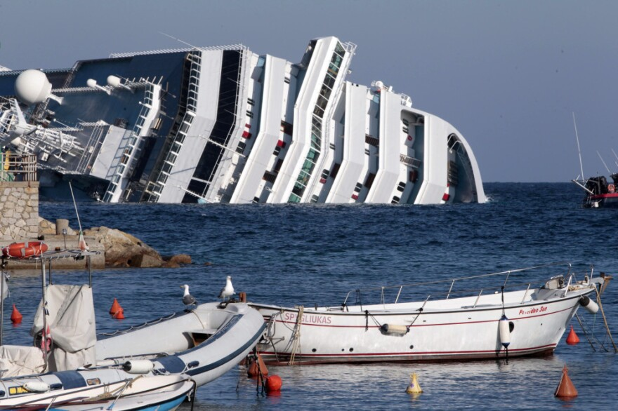 "The luxury cruise ship Costa Concordia leans on its side after running aground on the tiny Tuscan island of Giglio, Italy. One maritime workers union called the disaster a ""wake-up call"" highlighting long-standing safety concerns and what it sees as lax regulation."