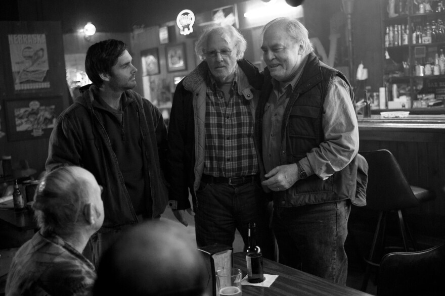 David (Will Forte, left) and his father, Woody (Bruce Dern, center), take time out of their quixotic journey to stop in Woody's small Nebraska hometown — where Woody's old business partner, Ed (Stacy Keach), is still nursing a grudge.