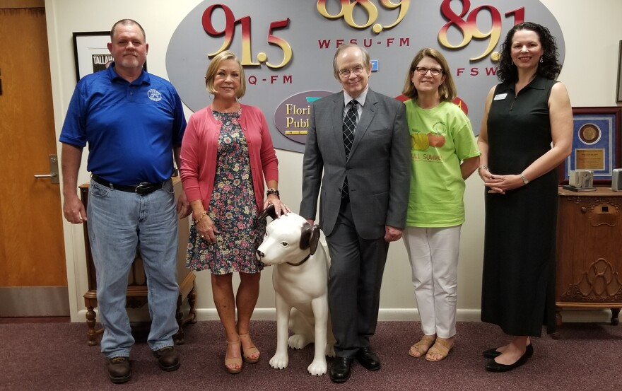 Tom and four guests standing in radio lobby