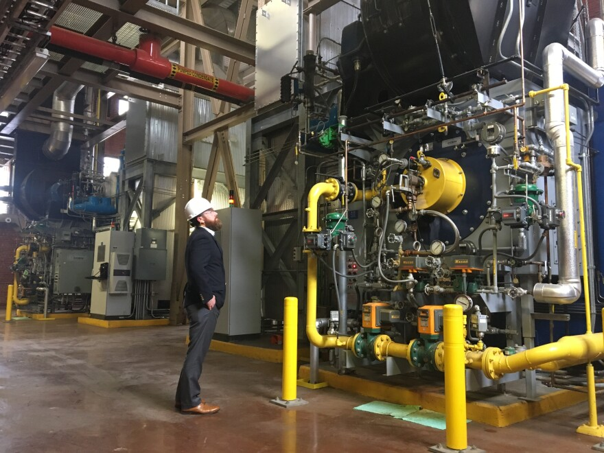 Casey Collins, Duke University energy manager, inspects a boiler at the West Campus Steam Plant. Soon, these boilers will run on swine biogas instead of natural gas.