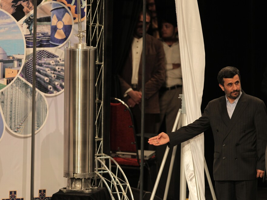 Former Iranian President Mahmoud Ahmadinejad unveils a sample of the third generation centrifuge during a ceremony to mark the National Nuclear Day  in Tehran on March 9, 2010.
