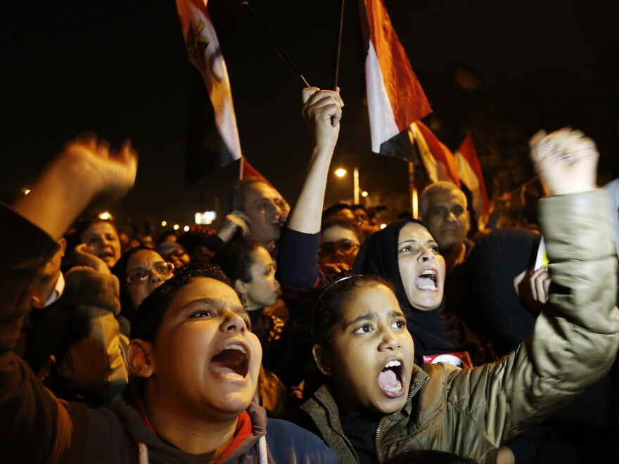 Protesters chant slogans during a demonstration in front of the presidential palace in Cairo, Egypt, on Sunday.