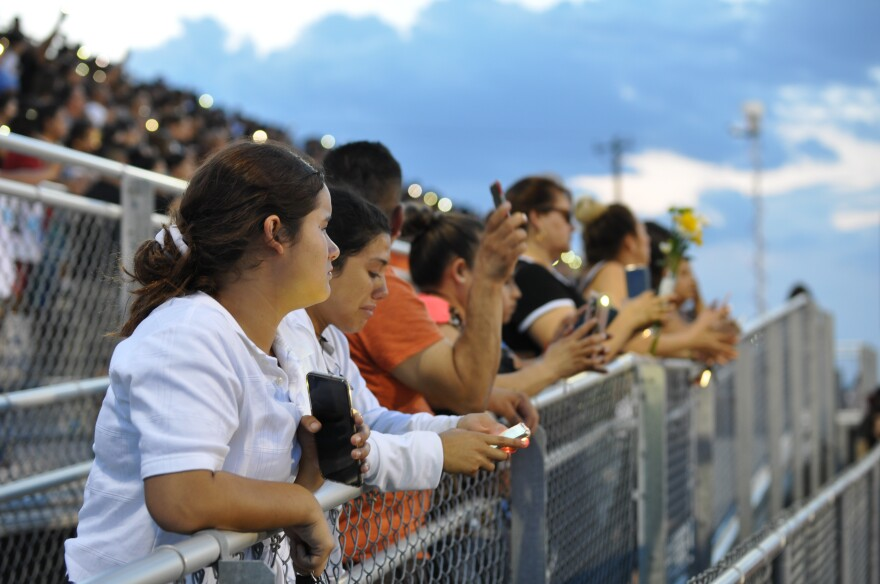 Members of the El Paso community pack the Horizon High School football stadium Monday for a vigil to honor 15-year-old Javier Amir Rodriguez, who died in a mass shooting Saturday.