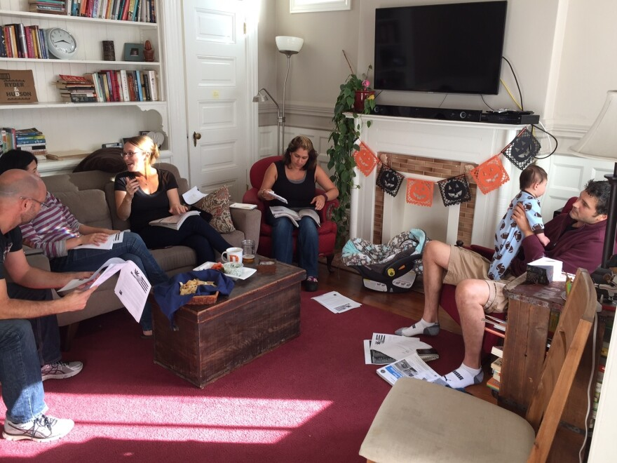 Deborah Barron, third from left, hosts a proposition party on Oct. 30 at her home in San Francisco's Mission District.