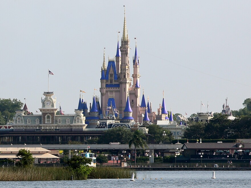 Cinderella Castle rises above Bay Lake at the Magic Kingdom at Walt Disney World on Saturday. Disney reopened two of its Florida parks after nearly four months of being closed due to the pandemic.