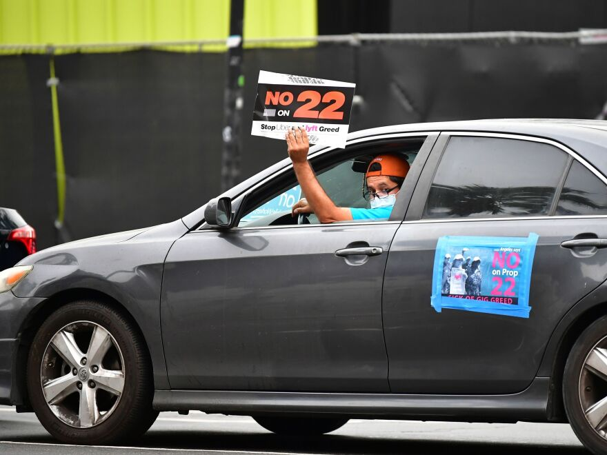 A California ballot measure over whether Uber and Lyft should treat their drivers as employees divided gig workers, but was approved by voters.