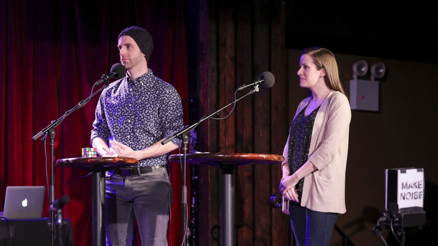 Contestants face off in the final round on <em>Ask Me Another</em> at the Bell House in Brooklyn, New York.