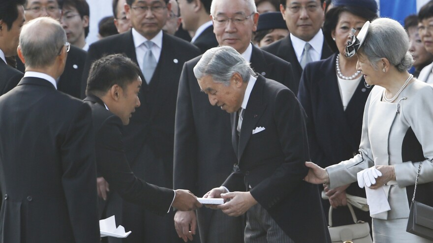 Actor turned lawmaker Taro Yamamoto (second left) hands a letter to Japan's Emperor Akihito, as Empress Michiko and chief steward Yutaka Kawashima (top center) look on during the autumn garden party at the Imperial Palace in Tokyo on Oct. 31.
