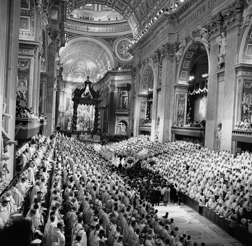 Pope John XXIII is carried on a portable throne down the aisle in St. Peter's Basilica on Oct. 11, 1962. Despite the pontiff's call for openness, certain issues — such as priestly celibacy — remained off-limits.