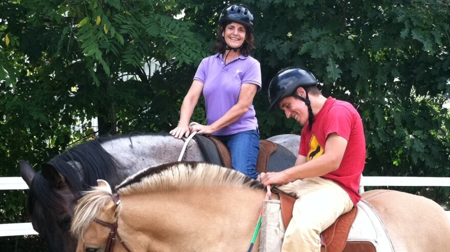Andy Tranfaglia, 23, who has Fragile X syndrome, rides a horse with his mother, Katie Clapp.