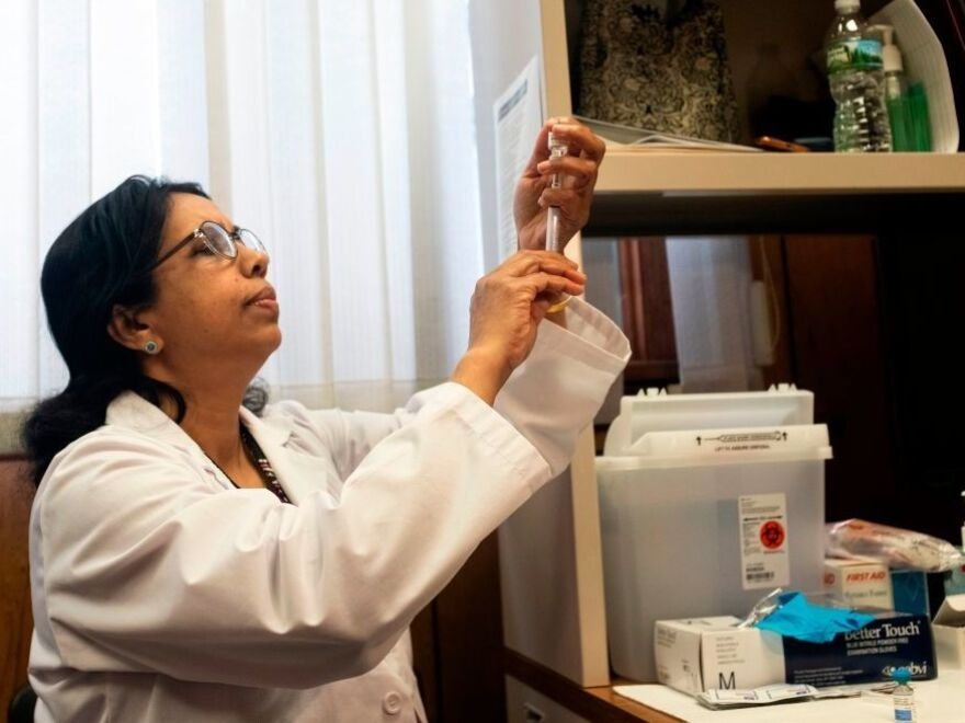 A nurse prepares the measles, mumps and rubella vaccine at the Rockland County Health Department in Haverstraw, N.Y. Several measles outbreaks in New York state are contributing to this year's unusually high measles rates.
