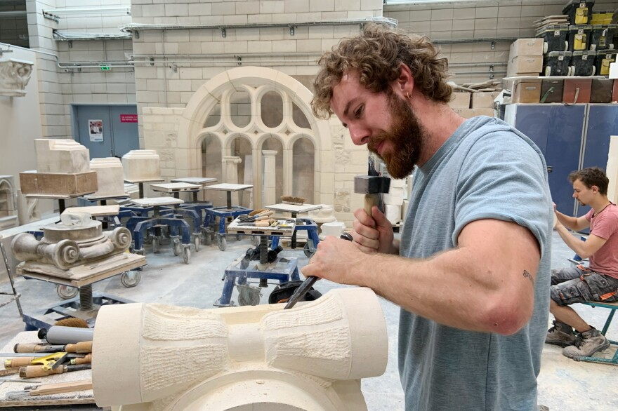 "François Menut works on the base of a Corinthian column. ""With stone carving, we give life to an edifice and perpetuate history. We're also creating a link with the past and transmitting values that are important to conserve in society,"" he says."