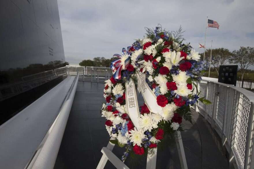 A wreath at the Space Memorial Wall pays tribute to the men and women who lost their lives while furthering the cause of exploration and discovery. Photo: NASA / KSC