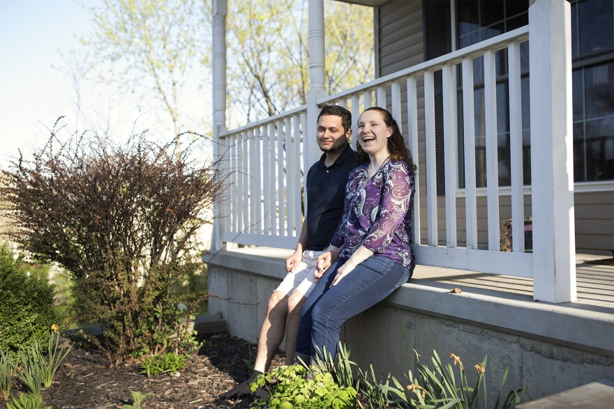 Michael and Danielle Abril pose for a portrait in front of their home in Kirkwood's Meacham Park neighborhood. April 2018