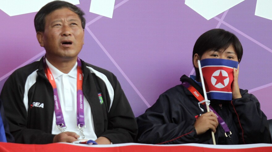 Supporters of North Korea's women's soccer team were dismayed to see the start of Wednesday's match delayed, after a video screen displayed the South Korean flag next to photos of the North Korean players.