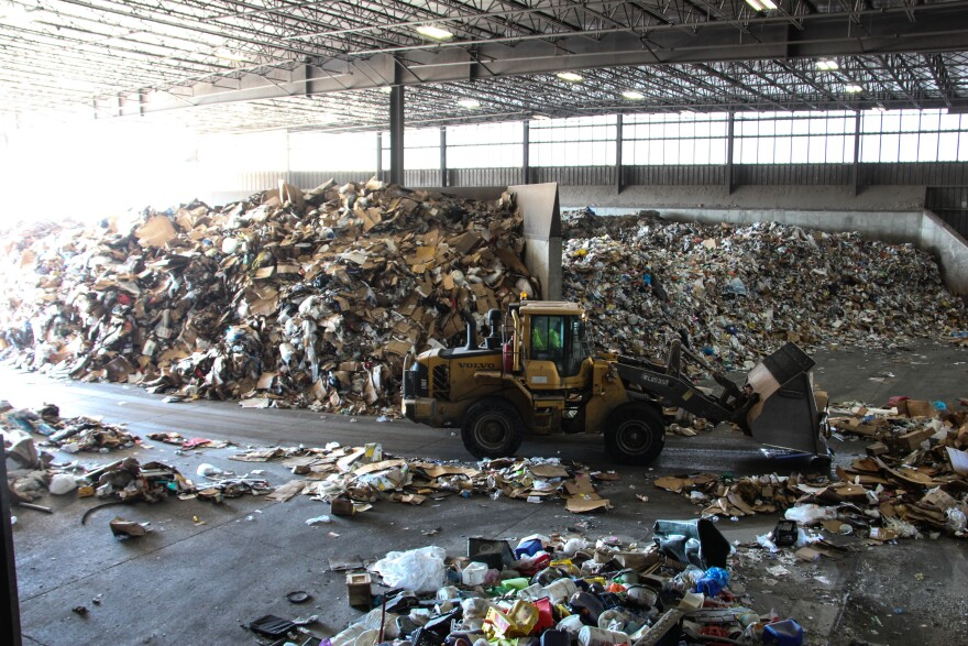 """The """"tip room"""" at Republic Services' processing plant in Hazelwood, where trucks bring in recycling."""