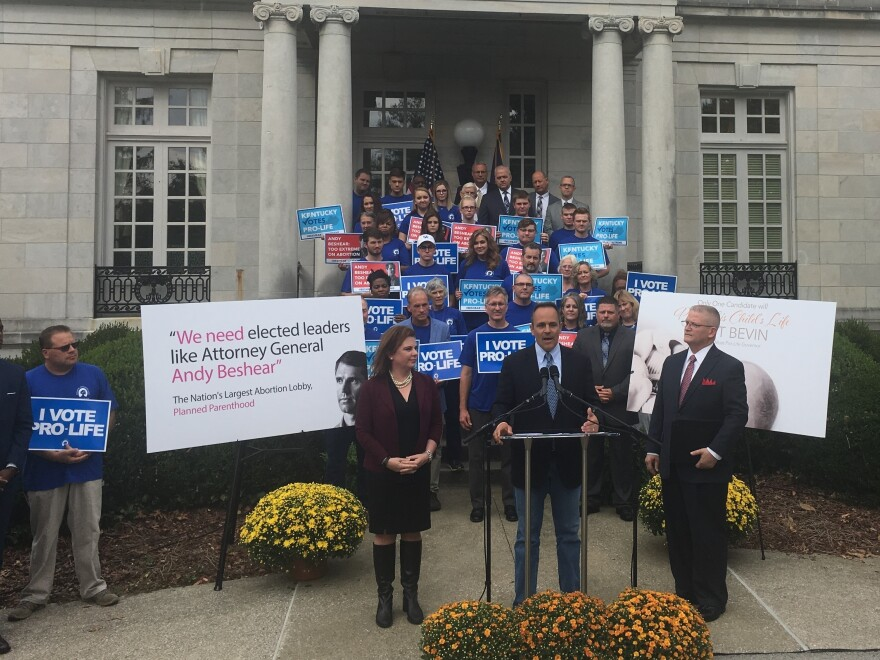 Republican Gov. Matt Bevin campaigns outside the governor's mansion in Frankfort, Ky., with anti-abortion-rights activists. Bevin has been a consistent and vocal opponent of abortion rights in Kentucky.