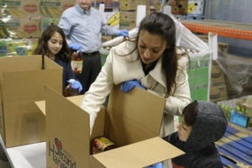 Commissioner-elect Nikki Fried boxing produce at Second Harvest of the Big Bend