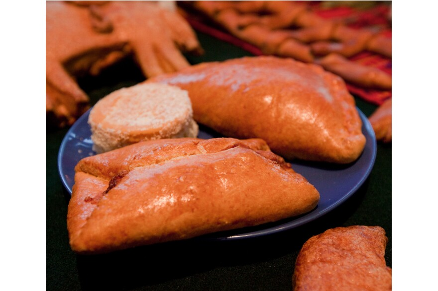 Pan de Muertos: Semisweet breads are baked with a small human figurine inside. It's considered good luck to find the tiny surprise in your slice. Breads are also used to represent the soil.