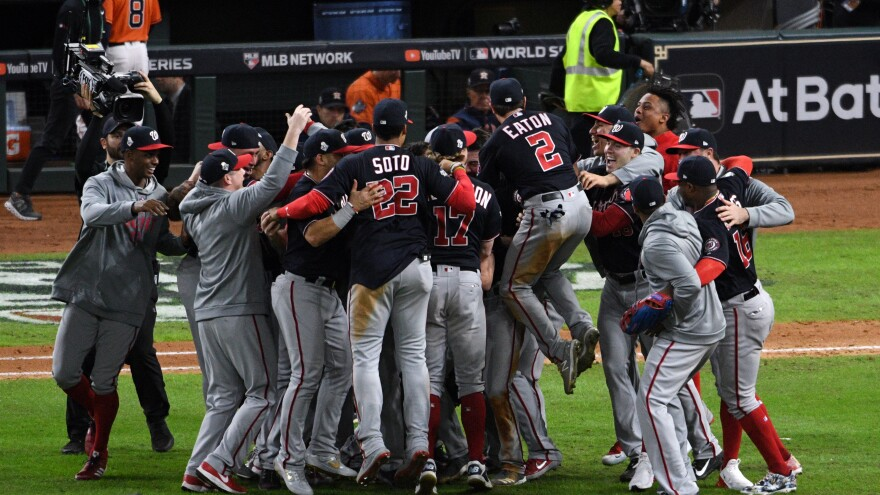 The Washington Nationals celebrate Wednesday after defeating the Houston Astros in Game 7 to win the World Series, at Minute Maid Park in Houston.