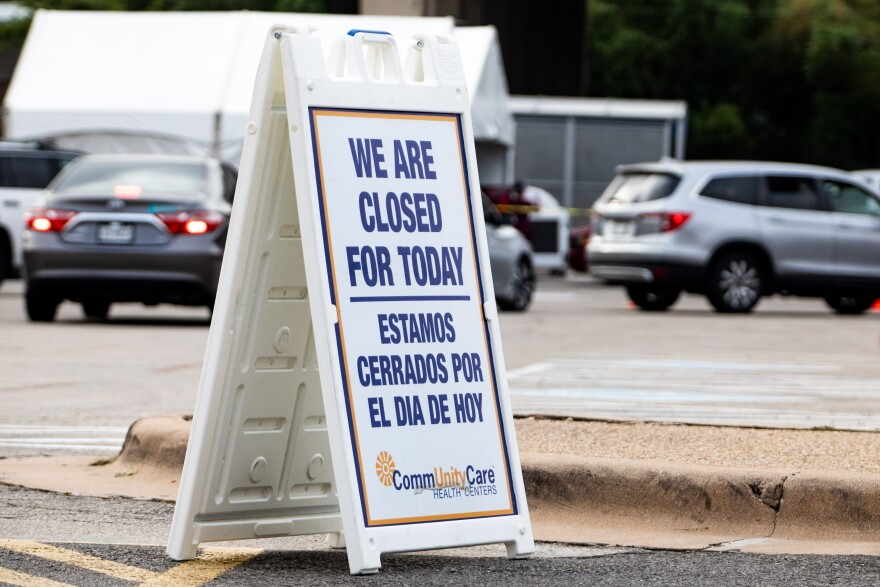 A sign indicates CommUnityCare's drive-thru testing is closed for the day. Locations have to close early if they reach capacity.