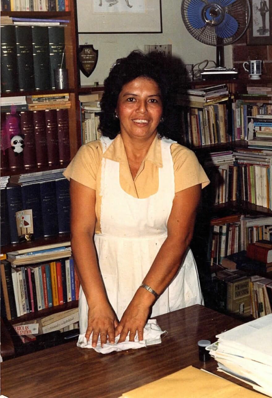 In this photo taken in 1984, Lucía Cerna cleans the office of Ignacio Martín-Baró, vice rector of the José Simeón Cañas Central American University.