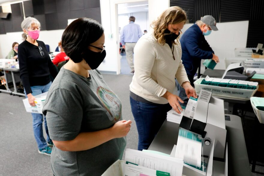 Workers start pre-processing absentee ballots at the city of Lansing Clerk's Election Unit in Lansing, Michigan.