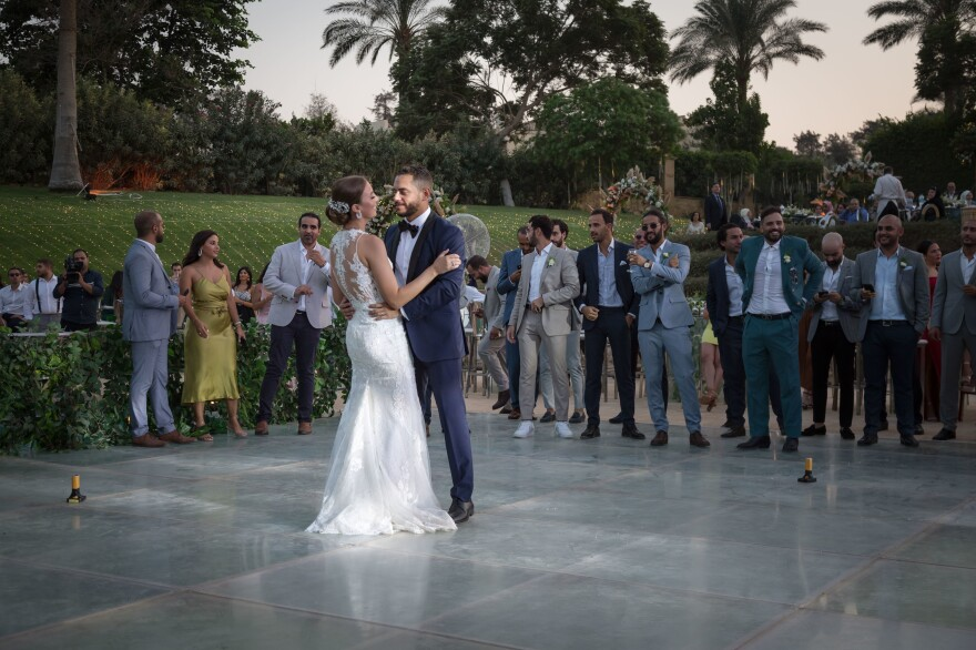 "Harazy and the groom, Adham Bagory, were married in a private garden. She overcame her fear of commitment and said yes to his proposal: ""Deep down, I know he's safe."""