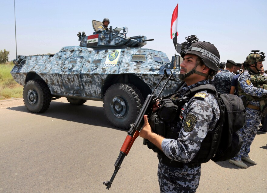 Iraqi policemen patrol Abu Ghraib, 25 miles west of Baghdad, in June. Islamic State militants have captured many cities and town in western Iraq this year. The government still controls Abu Ghraib, but the militants are nearby and local tribes are also restive.