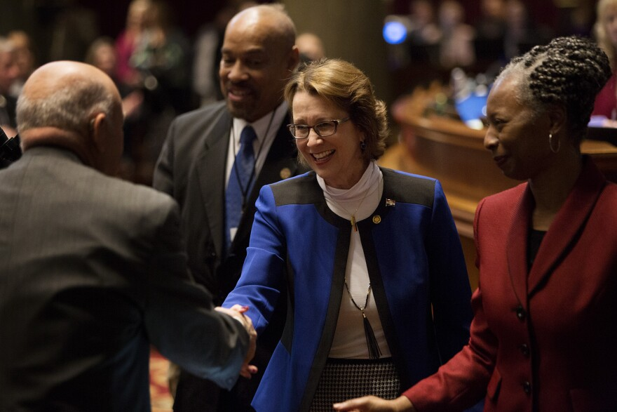 Rep. Trish Gunby greets fellow House of Representatives members after being sworn in on the first day of the Missouri legislative session. (Jan. 8, 2020)