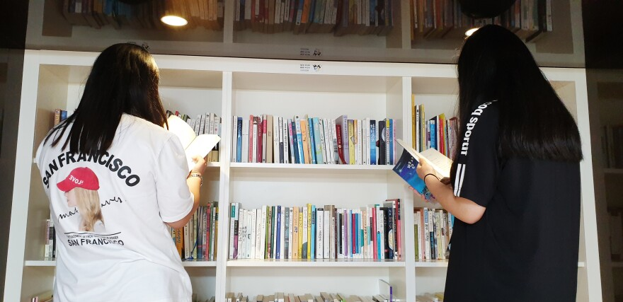Two young women browse the library at the National Center for Youth Internet Addiction Treatment in Muju, South Korea.