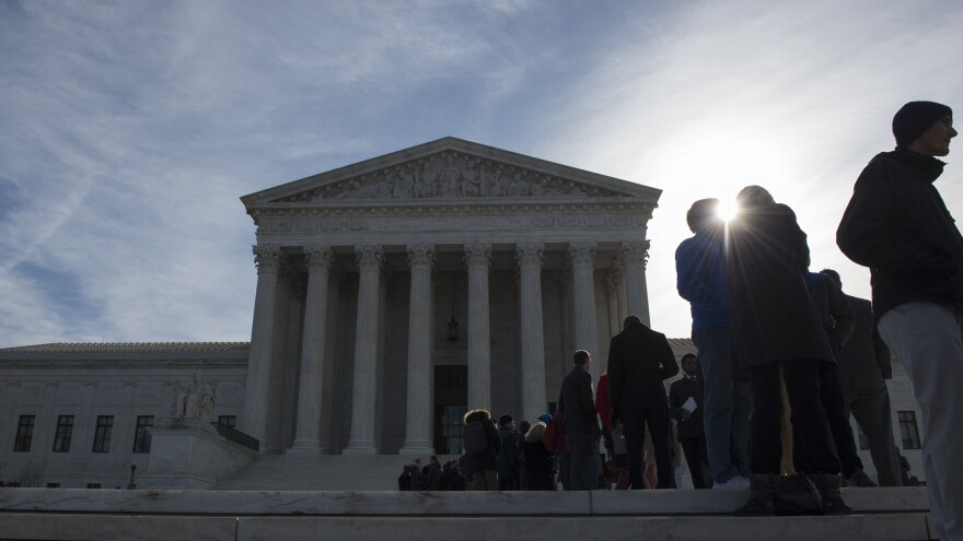 People wait in line outside the Supreme Court in March. There is a public line and a separate line reserved for members of the Supreme Court bar.